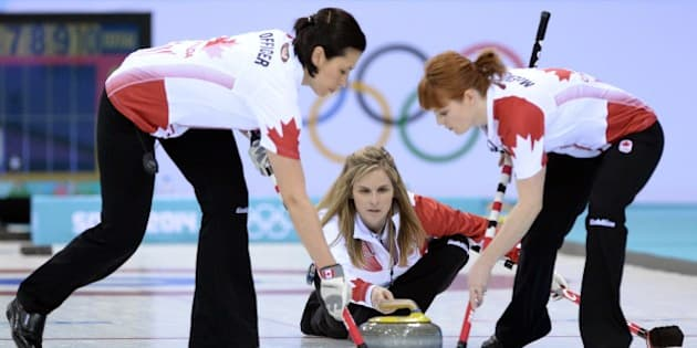 Canada's Jennifer Jones throws the stone during the Women's Curling Round Robin Session 1 at the Ice Cube Curling Center during the Sochi Winter Olympics on February 10, 2014.  AFP PHOTO / ANDREJ ISAKOVIC        (Photo credit should read ANDREJ ISAKOVIC/AFP/Getty Images)