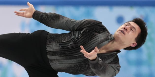 Patrick Chan of Canada competes in the men's team short program figure skating competition at the Iceberg Skating Palace during the 2014 Winter Olympics, Thursday, Feb. 6, 2014, in Sochi, Russia. (AP Photo/Ivan Sekretarev)