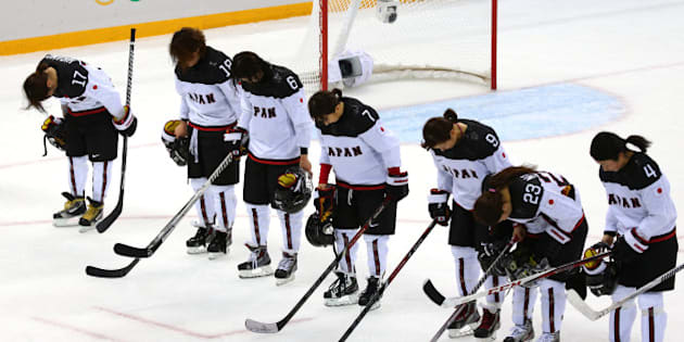 SOCHI, RUSSIA - FEBRUARY 11:  Team Japan looks on after being defeated 2 to 1 by Team Russia after their Women's Ice Hockey Preliminary Round Group B game on day four of the Sochi 2014 Winter Olympics at Shayba Arena on February 11, 2014 in Sochi, Russia.  (Photo by Martin Rose/Getty Images)