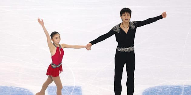 SOCHI, RUSSIA - FEBRUARY 11:  Narumi Takahaski and Ryuichi Kihara of Japan compete during the Figure Skating Pairs Short Program on day four of the Sochi 2014 Winter Olympics at Iceberg Skating Palace on February 11, 2014 in Sochi, Russia.  (Photo by Matthew Stockman/Getty Images)