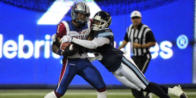 TORONTO, ON - SEPTEMBER 3  -   Montreal's Arland Bruce (left) makes a touchdown catch with pressure by Toronto's Jermaine Gabriel during the 1st half as the Toronto Argonauts host the Montreal Alouettes during CFL action at the Rogers Centre on September 3, 2013.        (Carlos Osorio/Toronto Star via Getty Images)