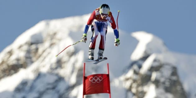 France's Alexis Pinturault makes a jump during men's downhill combined training at the Sochi 2014 Winter Olympics, Thursday, Feb. 13, 2014, in Krasnaya Polyana, Russia.  (AP Photo/Charles Krupa)