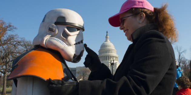WASHINGTON, DC - DECEMBER 1: Dieter Jobe, dress as a stormtrooper gets attention from his wife Shannon O'Connor-Jobe  (right) near the reflecting pool at the Capitol in Washington, DC on December 1, 2013. Jobe was part of the Museum of Science Fiction and members of the 501st Legion, a Star Wars costuming organization making a promotional video to publicize the Museum of Science Fiction; it will be the worlds first comprehensive science fiction museum. (Photo by Michel du Cille/The Washington Post via Getty Images)