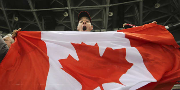 Sochi, Russia - February 12  -  SSOLY- Canadian fan Edward Cowie celebrates the Canadian victory.