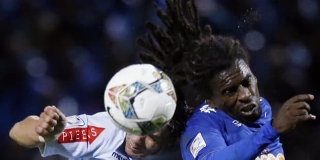 Garcilaso player Ramon Rodriguez vies fro the ball against Tinga of Cruzeiro during their first round game of the Group 5 of the Libertadores Cup played on February 12, 2014 in the Andean city of Huancayo, 300 kilometres east of Lima and more than 3,200 meters above sea level. AFP PHOTO/LUKA GONZALES        (Photo credit should read CRIS BOURONCLE/AFP/Getty Images)