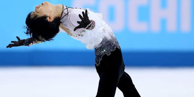 SOCHI, RUSSIA - FEBRUARY 14:  Yuzuru Hanyu of Japan competes during the Figure Skating Men's Free Skating on day seven of the Sochi 2014 Winter Olympics at Iceberg Skating Palace on February 14, 2014 in Sochi, Russia.  (Photo by Matthew Stockman/Getty Images)