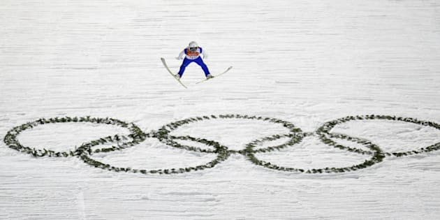 SOCHI, RUSSIA - FEBRUARY 14:  Daiki Ito of Japan jumps during the Men's Large Hill Individual Qualification on day 7 of the Sochi 2014 Winter Olympics at the RusSki Gorki Ski Jumping Center on February 14, 2014 in Sochi, Russia.  (Photo by Lars Baron/Getty Images)