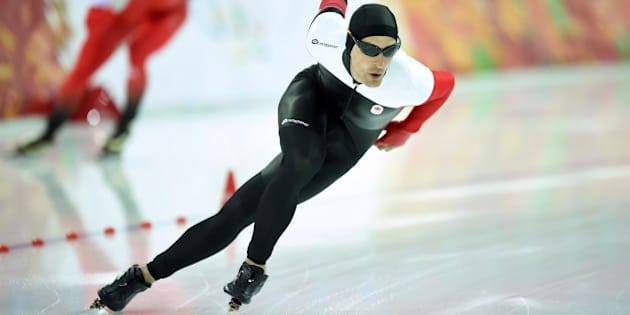 Canada's Denny Morrison competes in the Men's Speed Skating 1500 m at the Adler Arena during the Sochi Winter Olympics on February 15, 2014.          AFP PHOTO / JUNG YEON-JE        (Photo credit should read JUNG YEON-JE/AFP/Getty Images)