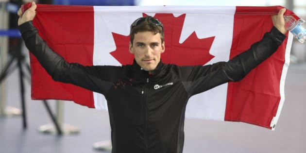 Sochi, Russia - February 15  -  SSOLY- Canada's Denny Morrison earned a bronze and makes his way to the flower ceremony. At the Winter Olympics in Sochi, the men's long track speed skating 1500 was held at the Adler arena. February 15, 2014        (Richard Lautens/Toronto Star via Getty Images)