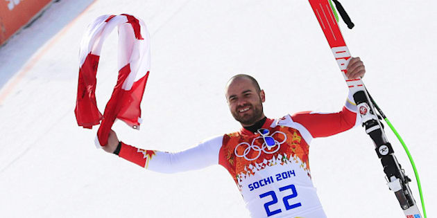 Canada's Jan Hudec poses on the podium for the Men's Alpine Skiing Super-G Flower Ceremony at the Rosa Khutor Alpine Center during the Sochi Winter Olympics on February 16, 2014.  AFP PHOTO / ALEXANDER KLEIN        (Photo credit should read ALEXANDER KLEIN/AFP/Getty Images)