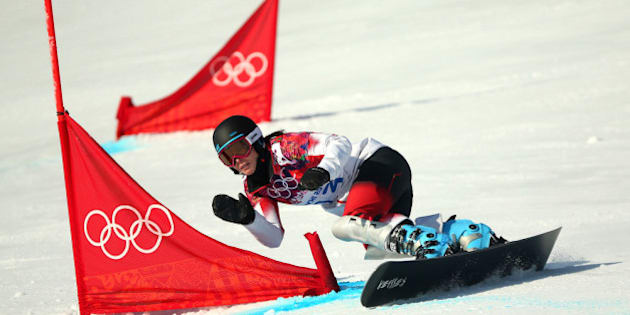 SOCHI, RUSSIA - FEBRUARY 19:  Caroline Calve of Canada competes in the Snowboard Ladies' Parallel Giant Slalom Qualification on day twelve of the 2014 Winter Olympics at Rosa Khutor Extreme Park on February 19, 2014 in Sochi, Russia.  (Photo by Mike Ehrmann/Getty Images)