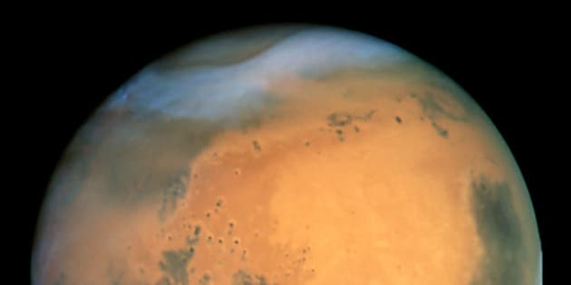MANDATORY CREDIT: NASA Hubble Space Telescope. Undated handout view taken by the NASA Hubble Space Telescope of the planet Mars, which passes closer to the Earth this week than it has at any time in almost 60,000 years. The precise time of closest approach will be 9.51am on Wednesday August 27 2003, when a mere 34,646,418 miles will separate the Earth and Mars - 145 times the distance to the Moon. Already it is impossible to miss the planet, a fiery yellow-orange disc in the south-eastern sky that far outshines the brightest star, Sirius. The event is a big occasion for amateur astronomers, who will have to wait 284 years for Mars to come as near again. See PA story SCIENCE MArs.  PA Photo. NASA Hubble Space Telescope.