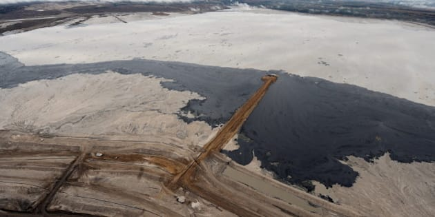 An aerial view of a tailings pond at the Suncor oil sands mine near the town of Fort McMurray in Alberta Province, Canada on October 23, 2009.  Greenpeace is calling for an end to oil sands mining in the region due to their greenhouse gas emissions and have recently staged sit-ins which briefly halted production at several mines. At an estimated 175 billion barrels, Alberta's oil sands are the second largest oil reserve in the world behind Saudi Arabia, but they were neglected for years, except by local companies, because of high extraction costs. Since 2000, skyrocketing crude oil prices and improved extraction methods have made exploitation more economical, and have lured several multinational oil companies to mine the sands.            AFP PHOTO/Mark RALSTON (Photo credit should read MARK RALSTON/AFP/Getty Images)