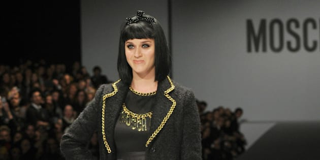 US singer Katy Perry attends the show  for fashion house Moschino as part of the Milan's Women's fashion week Autumn/Winter 2014 collections on February 20, 2014. AFP PHOTO / TIZIANA FABI        (Photo credit should read TIZIANA FABI/AFP/Getty Images)