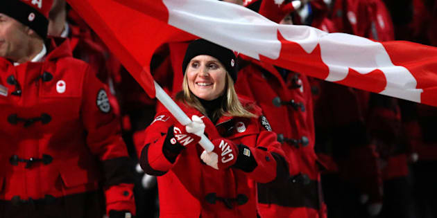 SOCHI, RUSSIA - FEBRUARY 7: Hayley Wickenheiser is the flag bearer for Canada during the Opening Ceremony of the 2014 Winter Olympic Games at the Fisht Olympic Stadium on February 7, 2014 in Sochi, Russia. (Photo by John Berry/Getty Images)