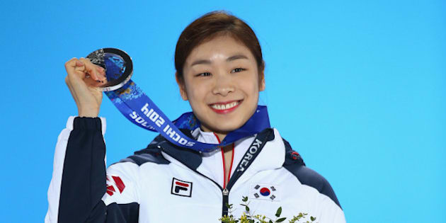 SOCHI, RUSSIA - FEBRUARY 21:  Silver medalist Yuna Kim of South Korea celebrates during the medal for the Women's Free Figure Skating on day fourteen of the Sochi 2014 Winter Olympics at Medals Plaza on February 21, 2014 in Sochi, Russia.  (Photo by Streeter Lecka/Getty Images)