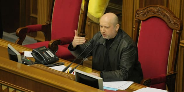 KIEV, UKRAINE - FEBRUARY 22:  Newly-appointed Speaker of the Parliament Oleksandr Turchynov delivers a speech during a session at Ukraine's parliament as a bill passed to release the former Ukrainian Prime Minister Yulia Tymoshenko who has been serving time in prison for more than two years in the capital Kiev, Ukraine on February 22, 2014. Tymoshenko, who has been in prison since August 2011, was convicted and sentenced to seven years imprisonment for abusing her powers as prime minister by ordering Ukrainian Naftogaz to sign a gas deal with Russia in 2009. (Photo by Bahadir Vanli/Anadolu Agency/Getty Images)