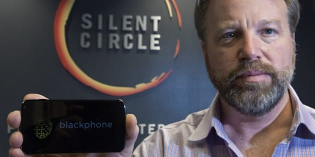 Mike Janke, CEO & Co-Founder of Silent Circle, makers of encrypted communications providing secure multiplatform communication services for mobile devices, desktop and email, holds a typical smart phone similar in styling to a new encrypted smartphone called, 'The Blackphone',  Silent Circle will be selling soon, seen here, January 16, 2014, at his National Harbor, Maryland office. The actual Blackphone that Silent Circle will be selling  is under wraps until it's official release date and will cost about what a unlocked Samsung Galaxy S4 or unlocked IPhone typically costs.        AFP PHOTO/Paul J. Richards        (Photo credit should read PAUL J. RICHARDS/AFP/Getty Images)