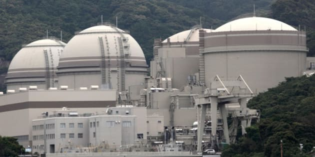 The No. 4, from left, No. 3, No. 2 and No. 1 reactor buildings stand at Kansai Electric Power Co.'s Ohi nuclear power station in Ohi Town, Fukui Prefecture, Japan, on Friday, June 1, 2012. Japan's government moved a step closer to resuming nuclear power generation after last year's Fukushima disaster left the country without atomic energy for the first time in more than four decades. Photographer: Tomohiro Ohsumi/Bloomberg via Getty Images