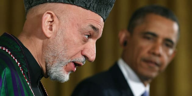 WASHINGTON, DC - JANUARY 11: U.S. President Barack Obama (R) and Afghan President Hamid Karzai speak to the media during a joint news conference in the East Room of the White House January 11, 2013 in Washington, DC. Karzai is in Washington for face-to-face meetings with Obama and senior members of his administration about the future of American commitment to Afghanistan and when troops may leave the country after more than 10 years of war. (Photo by Mark Wilson/Getty Images)
