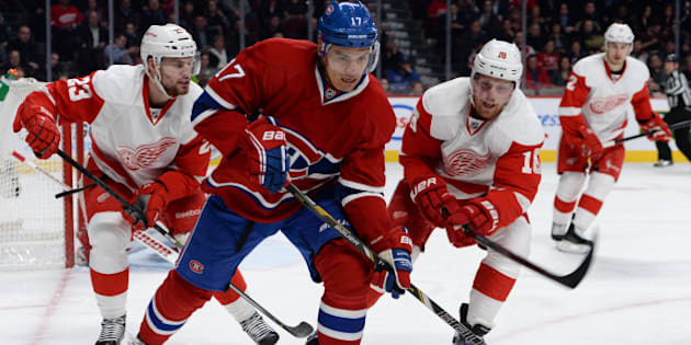 MONTREAL, QC - FEBRUARY 26:  Rene Bourque #17 of the Montreal Canadiens controls the puck while being challenged by Brian Lashoff #23 and Joakim Andersson #18 of the Detroit Red Wings during the NHL game on February 26, 2014 at the Bell Centre in Montreal, Quebec, Canada. (Photo by Francois Lacasse/NHLI via Getty Images)