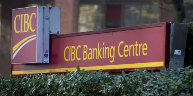 Canadian Imperial Bank of Commerce (CIBC) signage is displayed outside a branch in Vancouver, British Columbia, Canada, on Tuesday, Feb. 25, 2014. Canadian Imperial is scheduled to release earnings figures on Feb. 27. Photographer: Ben Nelms/Bloomberg via Getty Images