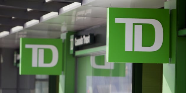 The logo of Toronto-Dominion Bank (TD) is displayed outside a Canada Trust branch in Vancouver, British Columbia, Canada, on Tuesday, Feb. 25, 2014. Toronto-Dominion is scheduled to release earnings figures on Feb. 27. Photographer: Ben Nelms/Bloomberg via Getty Images