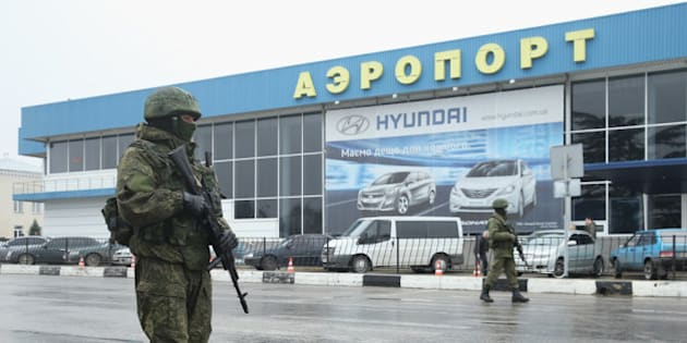 SIMFEROPOL, UKRAINE - FEBRUARY 28:  Soldiers, who were wearing no identifying insignia and declined to say whether they were Russian or Ukrainian, patrol outside the Simferopol International Airport after a pro-Russian crowd had gathered on February 28, 2014 near Simferopol, Ukraine. According to media reports Russian soldiers have occupied the airport at nearby Sevastapol in a move that is raising tensions between Russia and the new Kiev government. Crimea has a majority Russian population and pro-Russian men have occupied government buildings in Simferopol. (Photo by Sean Gallup/Getty Images)