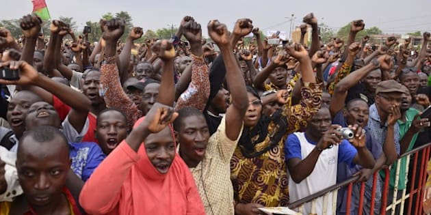 Burkinese opposition supporters shout slogans during a protest at Nation Square in Ouagadougou on January 18, 2014. Burkina Faso's opposition leader Zephirin Diabre has called for protests against plans by President Blaise Compaore to extend his mandate by another five years. AFP PHOTO/AHMED OUOBA        (Photo credit should read AHMED OUOBA/AFP/Getty Images)