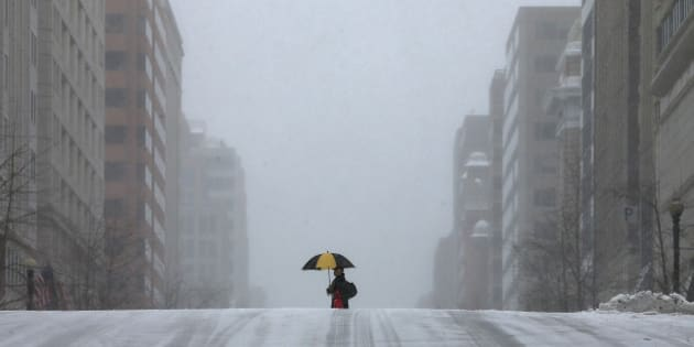 WASHINGTON, DC - MARCH 03: A man walks along a snow covered street, on March 3, 2014 in Washington, DC. The federal governent is closed due to major snowstorm that is expected to dump up to a foot of snow in the Washington area.  (Photo by Mark Wilson/Getty Images)