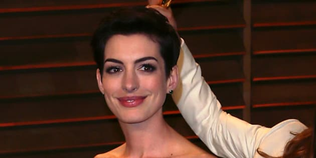 WEST HOLLYWOOD, CA - MARCH 02:  Actor Jared Leto photobombs actress Anne Hathaway at the 2014 Vanity Fair Oscar Party hosted by Graydon Carter on March 2, 2014 in West Hollywood, California.  (Photo by David Livingston/Getty Images)