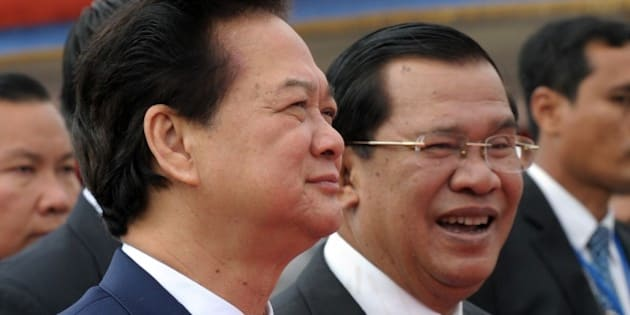 Vietnamese Prime Minister Nguyen Tan Dung (L) walks with Cambodian Prime Minister Hun Sen (R) during the official inauguration ceremony of Cho Ray-Phnom Penh hospital in Phnom Penh on January 13, 2014.  Nguyen Tan Dung began a three-day working visit to Cambodia aimed at boosting bilateral ties.     AFP PHOTO / TANG CHHIN SOTHY        (Photo credit should read TANG CHHIN SOTHY/AFP/Getty Images)