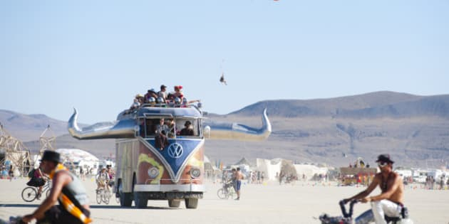 BLACK ROCK CITY, NV - SEPT 2: Like a scene from the World's Fairs of yesteryear, 2011 Burning Man participants intermingle with an oversized VW Van art car, balloon paraglider, and a thriving bicycle community. (Photo by Keith Carlsen For the Washington Post)