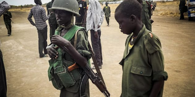 SOUTH SUDAN - MARCH 3:  Child soldier is seen in military uniform in the South Sudan Democratic Movement/Army (SSDM/A), Jonglei State, South Sudan on March 1, 2014. (Photo by Samir Bor/Anadolu Agency/Getty Images)
