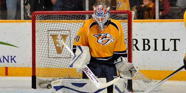 NASHVILLE, TN - JANUARY 18:  In his first game as a member of the Nashville Predators goalie Devan Dubnyk #40 warms up prior to a game against the Colorado Avalanche at Bridgestone Arena on January 18, 2014 in Nashville, Tennessee.  (Photo by Frederick Breedon/Getty Images)