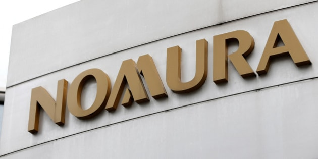 Signage for Nomura Securities Co. is displayed outside one of its branches in Tokyo, Japan, on Sunday, Oct. 28, 2012. Nomura Holdings Inc. is scheduled to announce first-half earnings today. Photographer: Kiyoshi Ota/Bloomberg via Getty Images