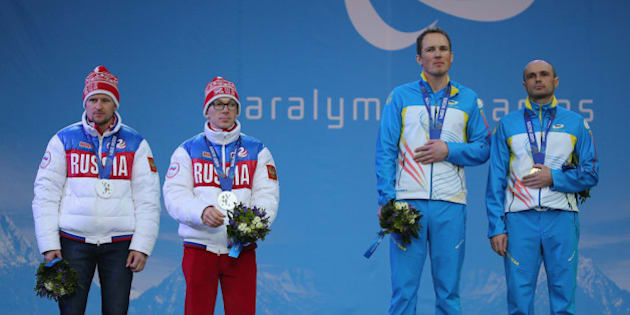 SOCHI, RUSSIA - MARCH 09:  Vitaliy Lukyanenko of Ukraine with guide, Borys Babar win gold in the Men's 7.5km Visually Impaired Biathlon during the 2014 Sochi Paralympic Games on March 9, 2014 in Sochi, Russia.  (Photo by Ian Walton/Getty Images)