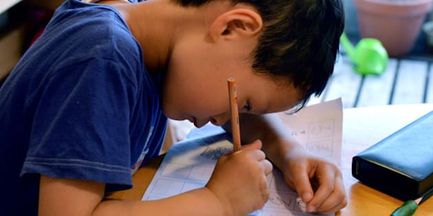 THIS IMAGE IS PART OF A PHOTO PACKAGE ON CHILDREN GOING TO SCHOOL AROUND THE WORLD Six-year-old Japanese elemetary student Seishi Nishida does his school work at home in Tokyo on June 10, 2013.  AFP PHOTO / Yoshikazu TSUNO        (Photo credit should read YOSHIKAZU TSUNO/AFP/Getty Images)