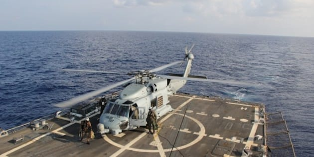 GULF OF THAILAND - MARCH 9:  In this handout provided by the U.S. Navy, a U.S. Navy MH-60R Sea Hawk helicopter from Helicopter Maritime Strike Squadron (HSM) 78, Det 2, assigned to the guided-missile Destroyer USS Pinckney (DDG 91), lands aboard Pinckney during a crew swap before returning on task in the search and rescue for the missing Malaysian airlines flight MH370 on March 9, 2013 at sea in the Gulf of Thailand. The flight had 227 passengers from 14 nations, mainly China, and 12 crew members. According to the Malaysia Airlines website, three Americans, including one infant, were also aboard. (Photo by Senior Chief Petty Officer  Chris D. Boardman/U.S. Navy via Getty Images)