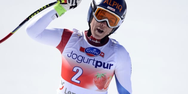 Switzerland's Fraenzi Aufdenblatten celebrates in the finish area after the women's downhill at the FIS alpine skiing World Cup finals on March 12, 2014 in Lenzerheide. AFP PHOTO / FABRICE COFFRINI        (Photo credit should read FABRICE COFFRINI/AFP/Getty Images)