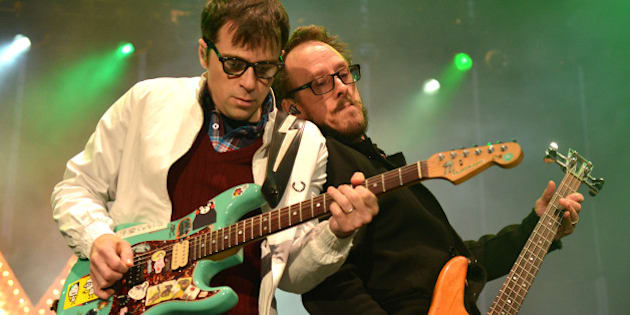 SAN FRANCISCO, CA - JULY 25:  Rivers Cuomo and Scott Shriner of Weezer perform at America's Cup Pavilion on July 25, 2013 in San Francisco, California.  (Photo by C Flanigan/FilmMagic)