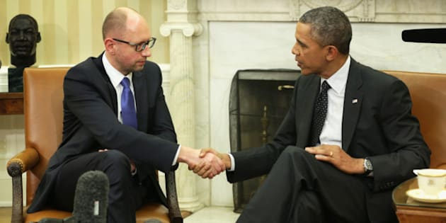 WASHINGTON, DC - MARCH 12:   U.S. President Barack Obama (R) shakes hands with Prime Minister of Ukraine Arseniy Yatsenyuk (L) during a bilateral meeting in the Oval Office of the White House March 12, 2014 in Washington, DC. Prime Minister Yatsenyuk was in Washington to discuss the current situation of the Russian military intervention in the Crimea area.  (Photo by Alex Wong/Getty Images)