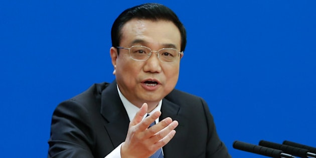 BEIJING, CHINA - MARCH 13:  Chinese Premier Li Keqiang speaks during a news conference after the closing session of the National People's Congress (NPC) at the Great Hall of the People on March 13, 2014 in Beijing, China. Chinese Premier Li Keqiang say in the new year to manage the environment and the eradication of corruption as a government priority.  (Photo by Lintao Zhang/Getty Images)