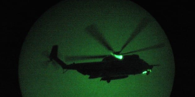 FALLUJAH, IRAQ - JULY 27:  A U.S. Special Forces MH-53 helicopter arrives to take U.S. Navy SEALS on a night mission to capture Iraqi insurgent leaders July 27, 2007 near Fallujah, Iraq. American Special Forces operate throughout Iraq, targeting 'high-value targets' in commando raids, often at night to take advantage of their night vision superiority.  (Photo by John Moore/Getty Images)