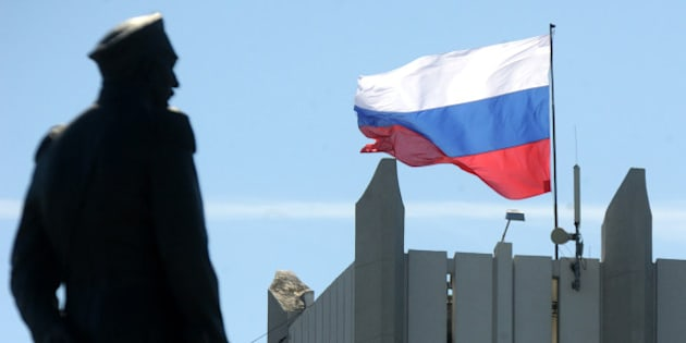 A Russian flag flutters on Sevastopol city hall on March 17, 2014. Crimea declared independence Monday and applied to join Russia while the Kremlin braced for sanctions after the flashpoint peninsula voted to leave Ukraine in a ballot that has fanned the worst East-West tensions since the Cold War.  AFP PHOTO/ VIKTOR DRACHEV        (Photo credit should read VIKTOR DRACHEV/AFP/Getty Images)