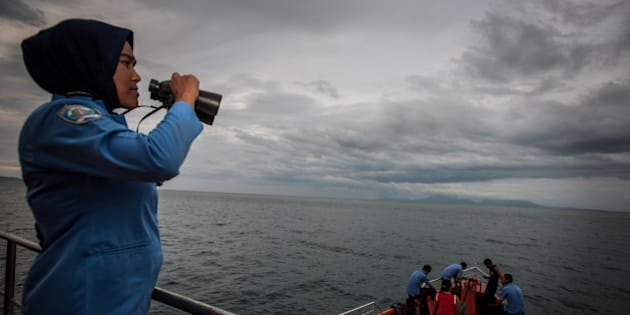 A personnel of Indonesia's National Search and Rescue looks over horizon during a search in the Andaman sea area around northern tip of Indonesia's Sumatra island for the missing Malaysian Airlines flight MH370 on March 17, 2014. The last words spoken from the cockpit of the Malaysian passenger jet that went missing 10 days ago were believed to have been spoken by the co-pilot, the airline's top executive said Monday.  AFP PHOTO / CHAIDEER MAHYUDDIN        (Photo credit should read CHAIDEER MAHYUDDIN/AFP/Getty Images)