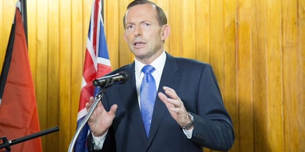 Australian Prime Minister Tony Abbott speaks at a joint press conference with Papua New Guinea's Prime Minister Peter O'Neill (not pictured) in Port Moresby on March 21, 2014.  China's President Xi Jinping is 'devastated' by the mysterious disappearance of Malaysia Airlines flight MH370, Australian Prime Minister Tony Abbott said after a phone call between the two. AFP PHOTO / NESS KERTON        (Photo credit should read Ness Kerton/AFP/Getty Images)