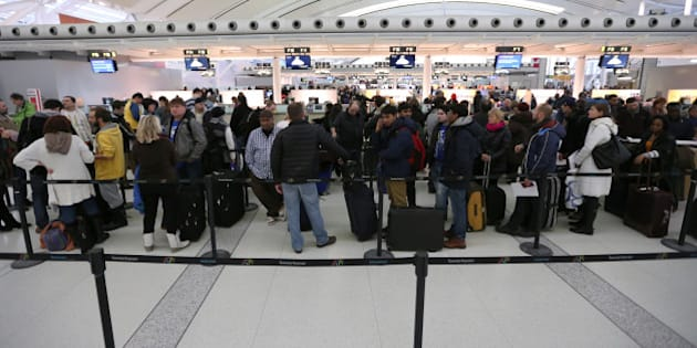 TORONTO, ON - JANUARY 11: Passengers in line up at Terminal 1 waiting to check in and receive boarding passes at Pearson International airport in Toronto on January 11, 2014.        (Vince Talotta/Toronto Star via Getty Images)