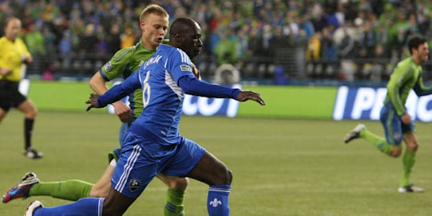 SEATTLE, WA - MARCH 02:  Andy Rose #25, of the Seattle Sounders, chases Hassoun Camara #6, of Montreal Impact, in the first half at CenturyLink Field on March 2, 2013 in Seattle, Washington.  (Photo by Kevin Casey/Getty Images)