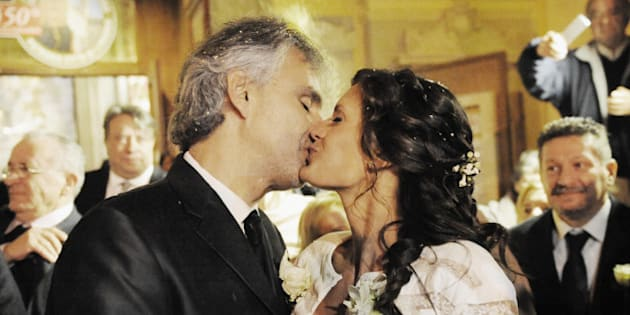 LIVORNO, ITALY - MARCH 21: Italian singer Andrea Bocelli and Veronica Berti kiss at Sanctuary of Madonna di Montenero after their wedding on March 21, 2014 in Livorno, Italy. (Photo by Laura Lezza/Getty Images)